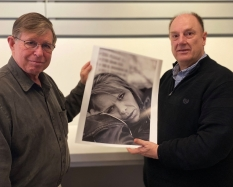 Photographer and Dartmouth alum Eric Hatch '68 with John Stomberg, the Virginia Rice Kelsey 1961s Director, in the Hood Museum's Bernstein Center for Object Study. Mr. Hatch gifted a suite of 10 photographs from his series, Faces of Addiction to the Hood.