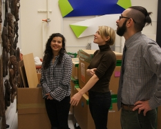 Left to right: Nikki, Meredith, and Andy in the museum's offsite storage facility. Photo by Alison Palizzolo.