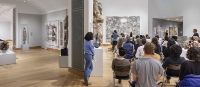 Museum visitors enjoy a performance in Lathrop Gallery. Photo copyright Michael Moran.