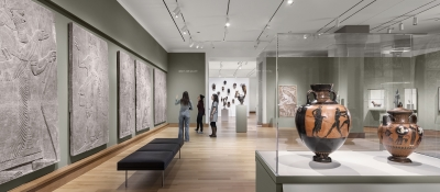 An installation of global ancient and premodern art in the newly renovated Kim Gallery, with an installation of traditional African art in the Albright Gallery beyond. Photograph © Michael Moran. Courtesy of the Hood Museum of Art, Dartmouth.