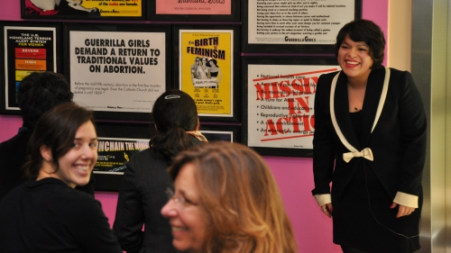 Julissa Llosa '10, Homma Family Curatorial Intern, gives a gallery talk on her A Space for Dialogue installation, Riot: Feminist Protest Art. Photo by Alison Palizzolo.