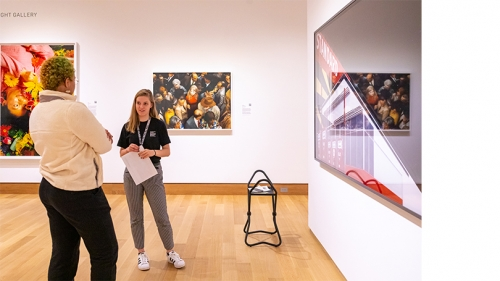 Photograph of Abby Smith '23 and student in Albright Gallery