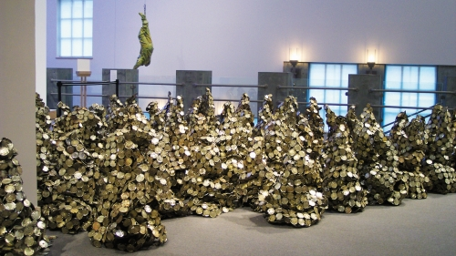 El Anatsui: GAWU featured visually stunning sculptures by the artist that were made from recycled materials. Photo by Jeffrey Nintzel.  El Anatsui: GAWU featured visually stunning sculptures by the artist that were made from recycled materials.