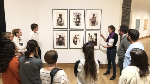 Students attending the West House Alternative Spring Break trip discuss a series of photographs by Nomusa Mahkubu.