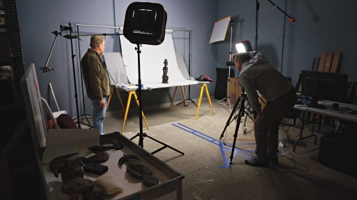 John Reynolds, lead preparator, and photographer Jeffrey Nintzel photographing three-dimensional African art objects from the Hood's permanent collection. Photo by Alison Palizzolo.