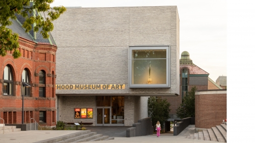 The facade of the Hood Museum of Art at dusk.