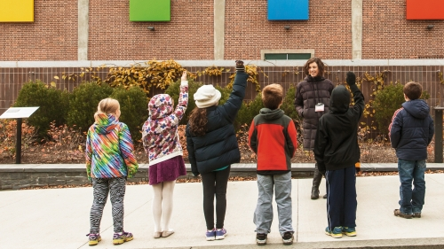Images and ArtStart Instructor Neely McNulty explores Ellsworth Kelly's Dartmouth Panels with a group of fifth graders. Photo by Tom McNeill.
