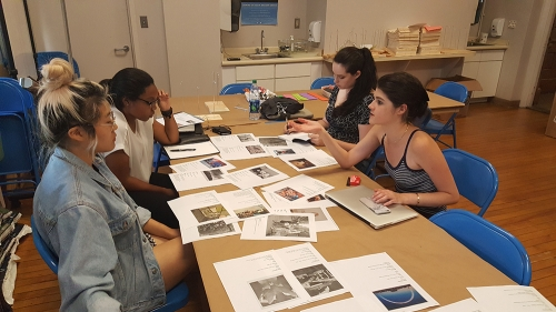 Hood interns discuss their group A Space for Dialogue installation. Photo by Amelia Kahl.