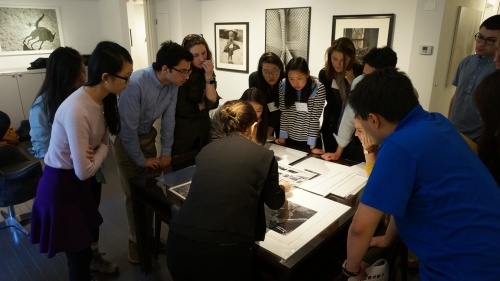 Students from the 2016 spring Museum Collecting 101 session review potential photographs in NYC for the museum to acquire. Photo by Amelia Kahl.