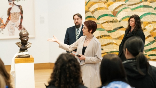 Juliette Bianco '94, deputy director of the Hood Museum of Art, gives a tour of the new galleries after the Hood reopened earlier this year.