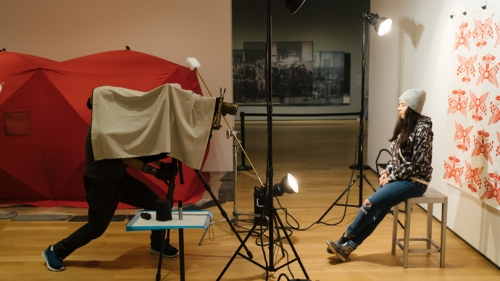 Photographer Will Wilson makes a tintype portrait of Gabe Canfield '21 as part of an exhibit at the Hood Museum of Art.