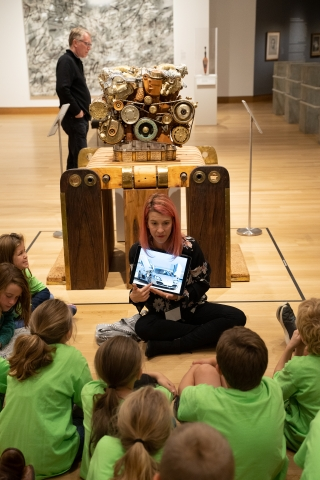 """A third grade class from Hanover Street School learns about Eric Van Hove's inspiration for V12 Laraki in their """"Artist as Collaborator lesson."""" Photo by Brian Wagner."""