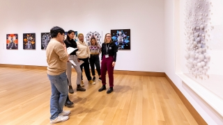 Museum Club member Sophia Swanson '23 speaks with students about Lin Tianmiao's Focus No. 30 (2003) during the winter 2020 Hood After 5 student party. Photo by Lars Blackmore.