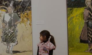 Child appreciating Native American art