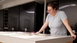 Grace Hanselman '20 studies photographs in Bernstein Study Storage.