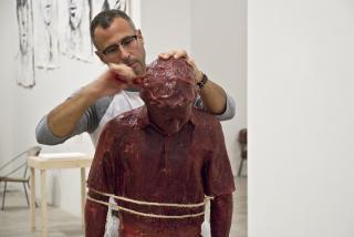 Enrique Martínez Celaya working on Burning as It Were a Lamp