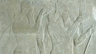 Reign of Ashurnasirpal II, The King and Genie: Relief from the Northwest Palace of Ashurnasirpal II at Nimrud (detail), 883-859 BCE, gypsum. Gift of Sir Henry Rawlinson through Austin H. Wright, Class of 1830; S.856.3.2.