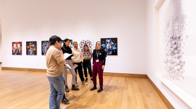 Museum Club member leads a Gallery Chat during a Hood After 5 event.
