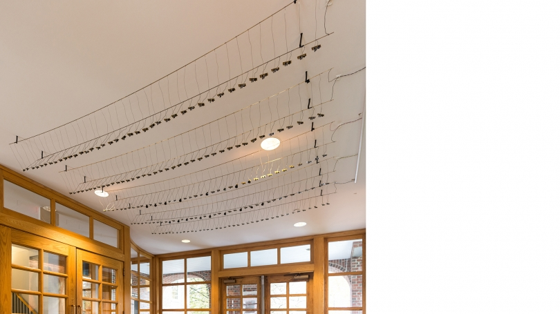 Fig. 10. Two hundred circuits mounted on ten brass rods made up the interior portion of Laura Maes's Spikes, 2017, Cummings Hall, Thayer School of Engineering. Photo by Joseph Beaudoin.