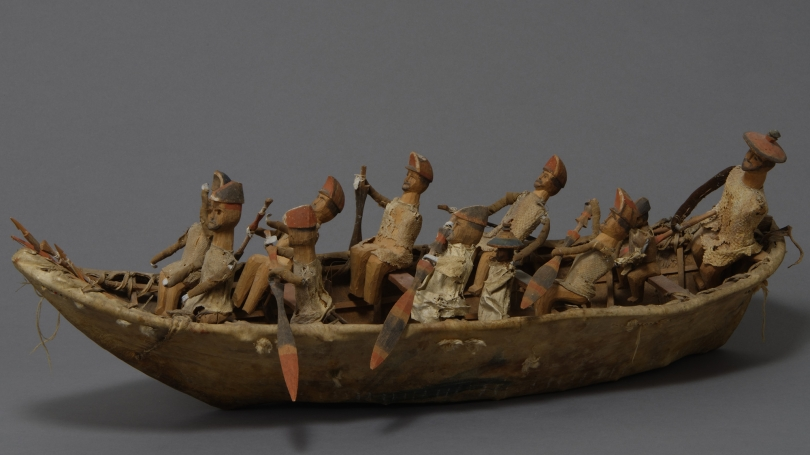 Unangax̂ (Aleut), Umiak Model, mid-19th century, wood, hide, cloth, lead hands, pitch, sinew, bird skin, ochre, and thread. Hood Museum of Art, Dartmouth: Gift of Captain Worthen Hall and Polly D. Lovewell Hall; 13.1.590.