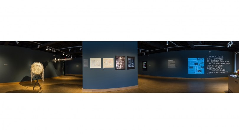Fig. 1. Panoramic view of Hood Downtown featuring work by Terry Adkins and Jess Rowland, 2017. Note the list of artists' names next to the introductory text panel and exhibition map on the righthand wall. Photo by Joseph Beaudoin.