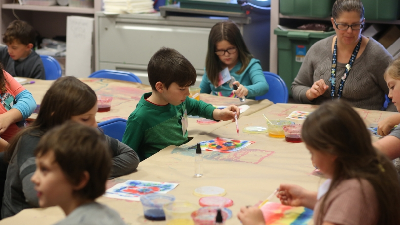 """A fourth grade Images class from Unity Elementary experiments with color mixing during their """"Artists and Water"""" lesson. Photo by Rob Strong."""