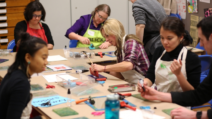 Participants create a work of art during a Maker Night event. Photography by Rob Strong.
