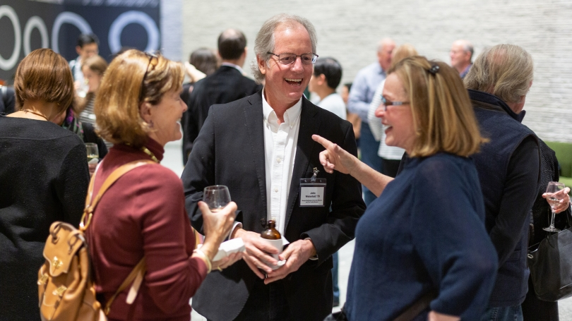 Symposium attendees chat with panelist John Wetenhall '79 during a reception during the The New Now: Art, Museums, and the Future. Photography by Rob Strong.