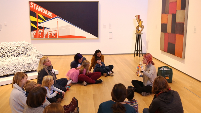 Museum Educator Jamie Rosenfeld reads to families during a Storytime in the Gallery program in November 2019. Photo by Rob Strong.