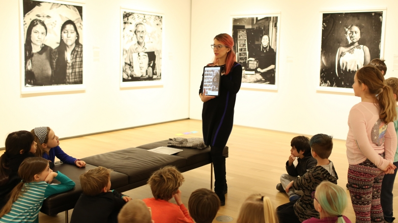 A third grade class from Grantham Village School learns about Kali Spitzer's and Will Wilson's reaction to Edward Curtis through the CIPX: Dartmouth exhibition. Photo by Rob Strong.