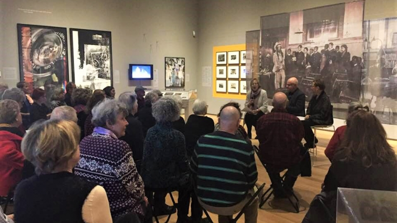 """A full gallery discusses school photos in """"Conversations and Connections: What Do School Photos Do?"""". Photo by Sharon Reed."""