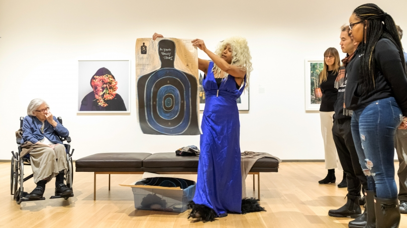 Artist Dell Hamilton performing Blues/Blank/Black in the galleries. Photography by Lars Blackmore.