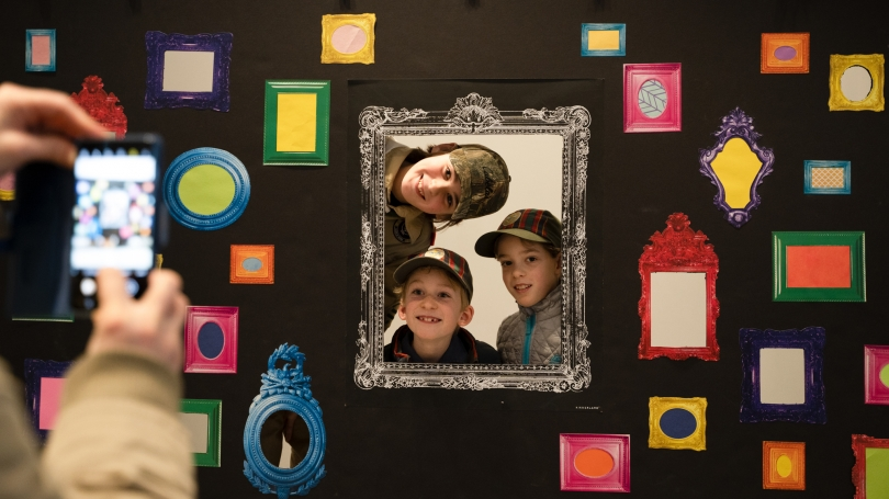 After exploring photographic portraiture in CIPX Dartmouth with Kali Spitzer and Will Wilson, Family Day: Strike a Pose! participants enjoy taking their own portraits together. Photo by Brian Wagner.
