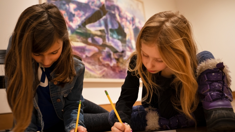 Family Day participants engage in creative writing in the galleries. Photo by Brian Wagner.
