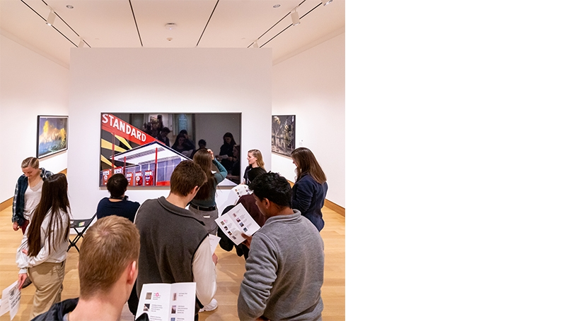 Photograph of Abby Smith '23 and students in Albright Gallery