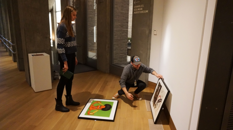 Allison Carey '20 lays out her Space for Dialogue exhibition When Art Intersects History with help from preparator Matt Zayatz.