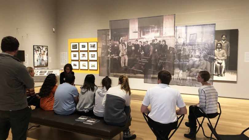 """Students in the spring 2020 Alternative Spring Break program run by the Dartmouth Center for Social Impact and West House visit the exhibition """"School Photos and Their Afterlives""""."""