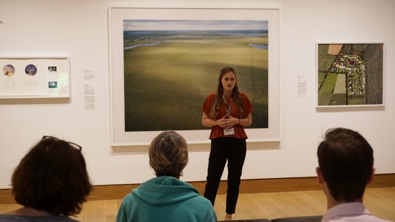"""Hood Intern Annabelle Bardenheier delivering a gallery talk in her """"A Space for Dialogue"""" installation """"Knowledge and Control."""" Photo by Amelia Kahl."""