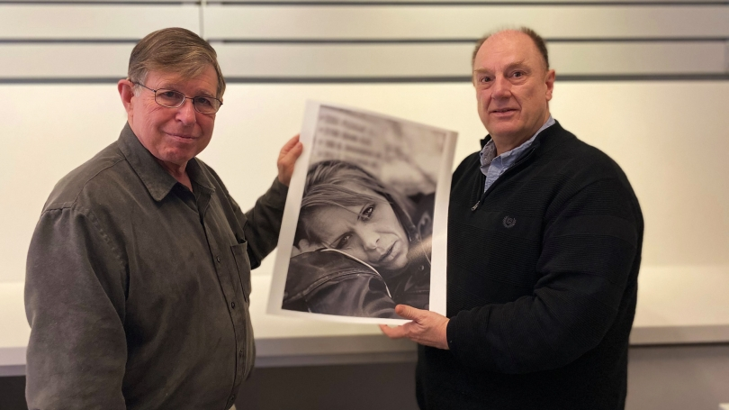 Photographer and Dartmouth alum Eric Hatch '68 with John Stomberg, the Virginia Rice Kelsey 1961s Director, in the Hood Museum's Bernstein Center for Object Study. Mr. Hatch gifted a suite of 10 photographs from his series, Faces of Addiction to the Hood