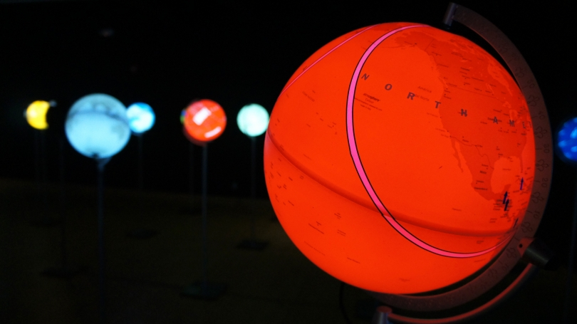 Ingo Günther, installation of the World Processor series at Hood Downtown, illuminated globes. Photo by Alison Palizzolo.