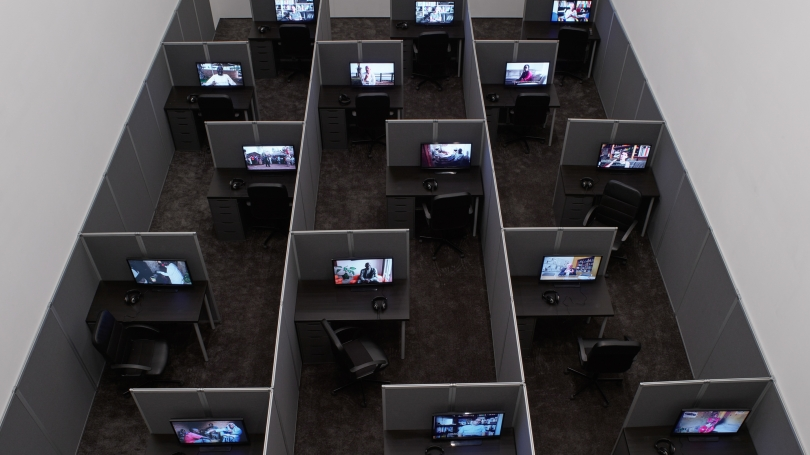 Kader Attia, Reason's Oxymorons, 2015, 18 films and installation of cubicles, duration: variable, 13 to 25 minutes, 55 x 262 x 468 inches (installed overall), Edition of 3. Photo: Max Yawney. Courtesy the Artist and Lehmann Maupin, New York and Hong Kong.