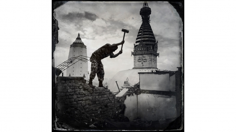 Kevin Bubriski, Members of the Nepalese Army assisted in the demolition of unsafe shops and houses on top of Swayambhunath Hill. The ancient stupa, or shrine, in the background, suffered no major damage, 2015, archival pigment digital print.