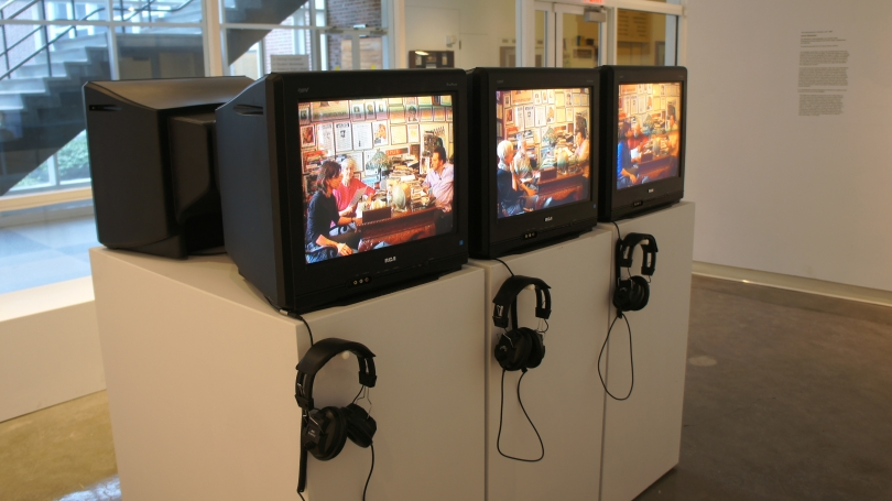 Nina Katchadourian, Accent Elimination, 2005, Six televisions, three pedestals, six-channel video (three synchronized programs and three loops), headphones and benches. Purchased through gifts from the Lathrop Fellows; 2008.36. Photo by Alison Palizzolo.