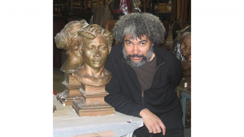 """Fred Wilson at the Hood Museum of Art during the installation of """"Fred Wilson: So Much Trouble in the World -- Believe it or Not!"""" (2006)."""