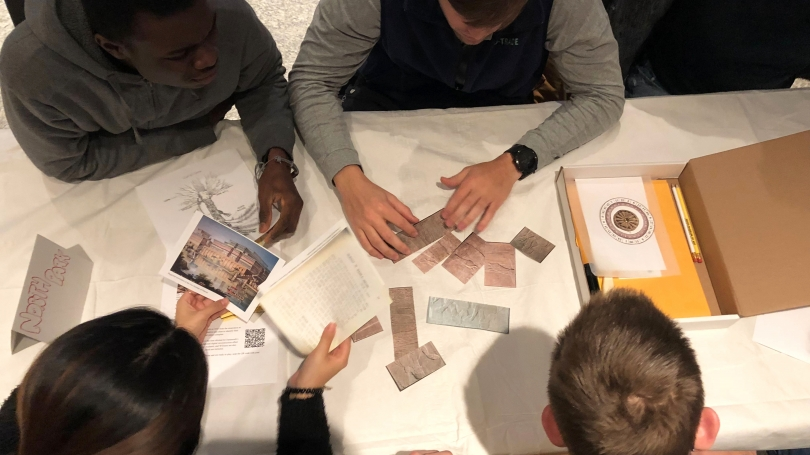 Students play the Assyrian Relief Escape Room Challenge in Russo Atrium as part of an intramural competition hosted by Dartmouth's housing communities. Photo by Hadley Detrick '22.