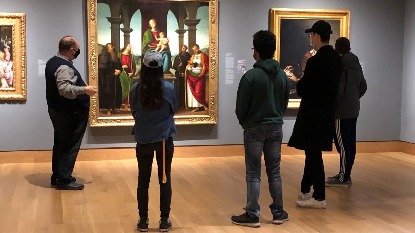 Director John Stomberg speaks to a group of students about the Perugino altarpiece, a work of art in the Hood's European art collection, during a Tiny Tour.