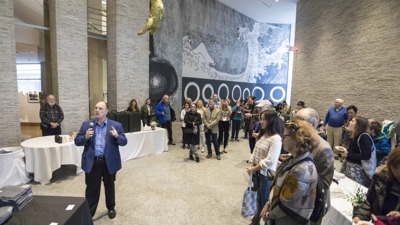 Director John Stomberg addresses visitors just before the doors officially reopen to the public at the Grand Reopening Celebration. Photo by Tom McNeil.