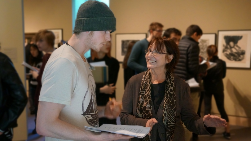 Professor of art history Joy Kenseth with her class in the Hood's Harrington Gallery. Photo by Alison Palizzolo.