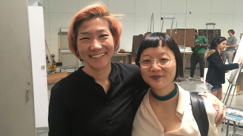 Christine Sun Kim (right) with Professor of Studio Art Soo Sunny Park (left) after Kim spoke to her class.