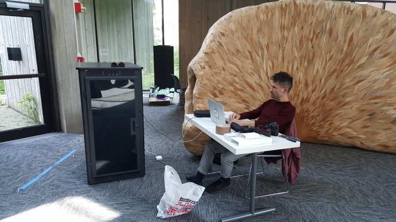 Jacob Kirkegaard adjusts the sound to fit the space of the Fairchild atrium.